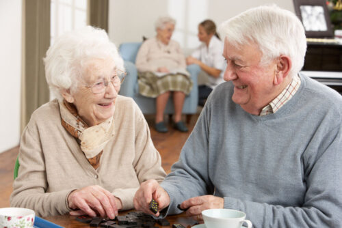 Couple in Seniors Home. Mediation can help adult children plan for parents' care.